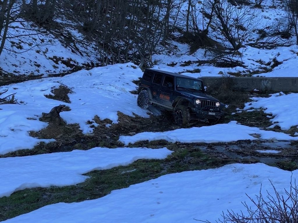 Offroad on Snow and Ice: We drive through the creek because turning around is not an option