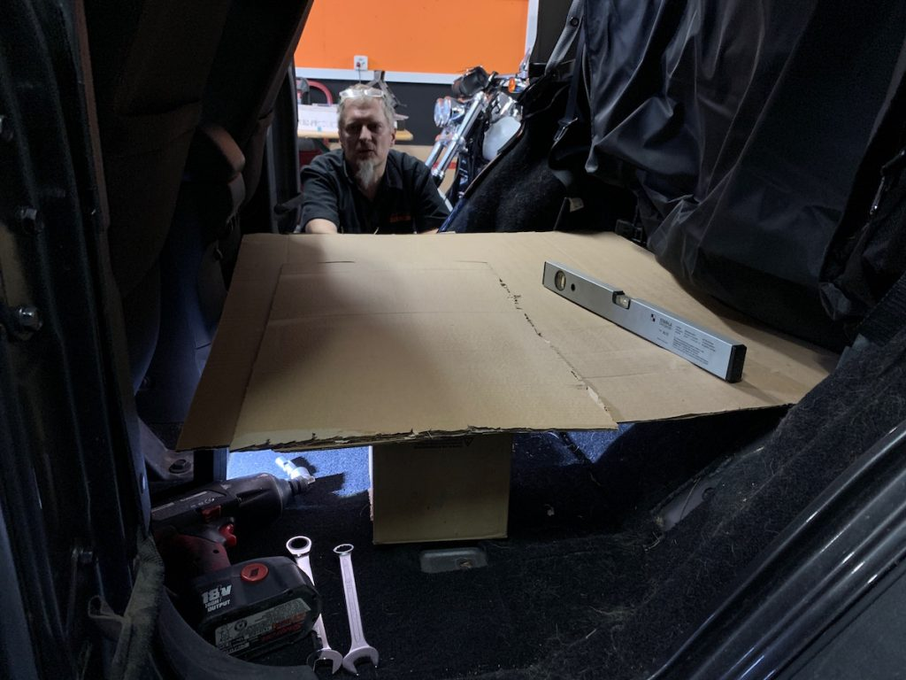 First, we wanted to mount the storage unit behind the front seats, where we demounted the back row
