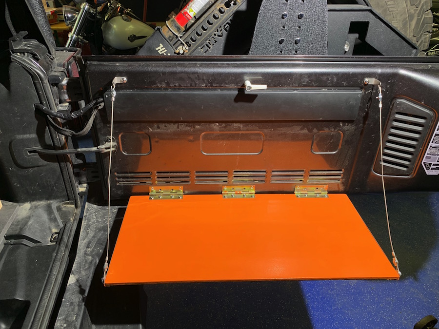Tray table on the inner side of the tailgate.