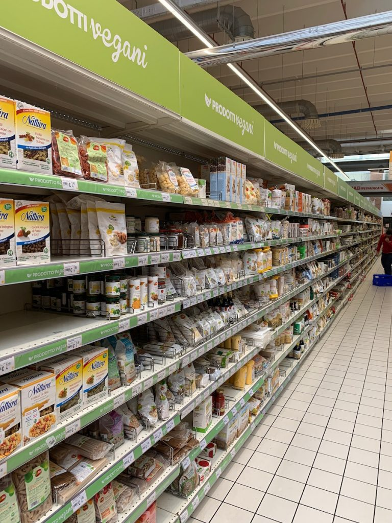 Vegan Tourists in Italy: Aisle with vegan and organic food in an Italian supermarket