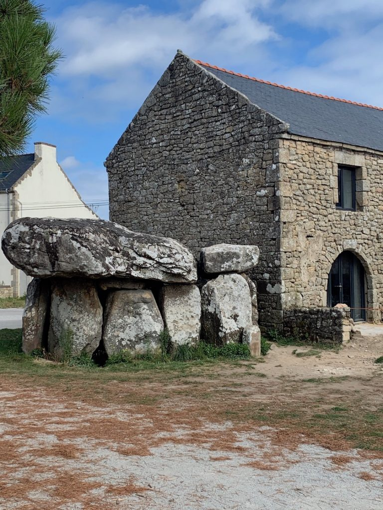 Dolmens and menhirs of Brittany: Dolmen of Crucuno right next to a farmhouse